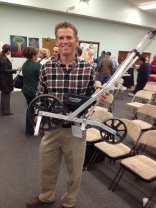 """Jason Harned and his favorite planting tool (which cost $100 but """"it's worth $1000."""")"""